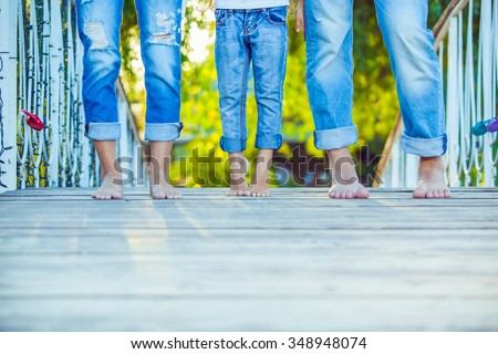 Happy Family on a Walk in Summer. Child with Parents Together. Feet Barefoot . Healthy Lifestyle. Dad Mom and Son. Spring Time. - stock photo