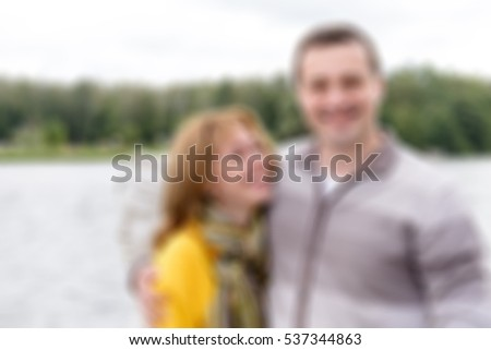 Happy family on a walk theme creative abstract blur background with bokeh effect