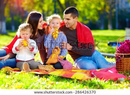 happy family on autumn picnic in park - stock photo