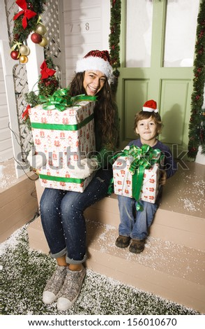 happy family on Christmas at house with gifts - stock photo