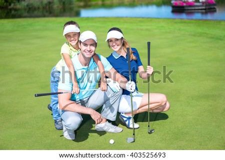 Happy family on golf course