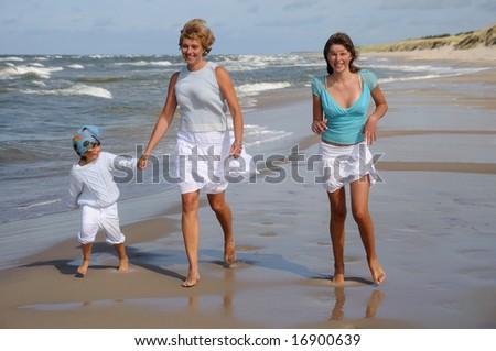 Happy family on holidays - stock photo
