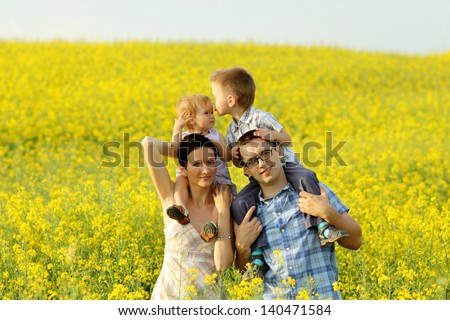 Happy family on nature - stock photo