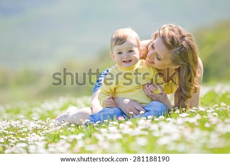 happy family on nature walks in the summer. mother and child run on field