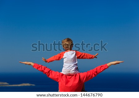 happy family on sea vacation with the sky on background - stock photo