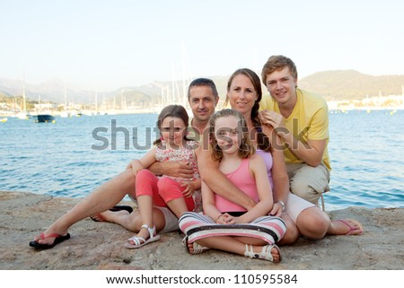happy family on summer vacation or holiday - stock photo