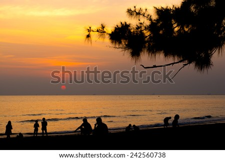 Happy family on the beach at sunrise for holiday time