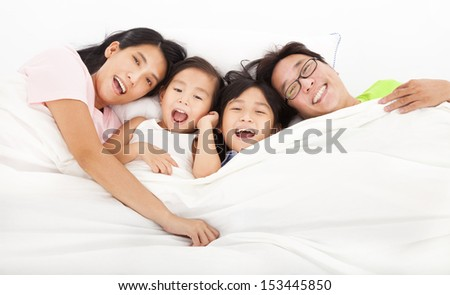 Happy   family on the bed - stock photo