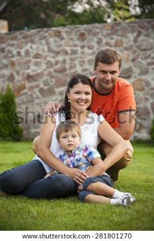 Happy family on the grass