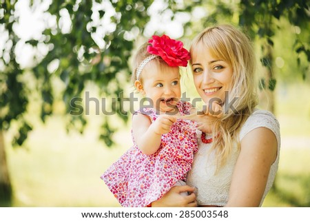 happy family on the nature of mother and daughter - stock photo