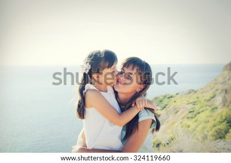 Happy family on the ocean - stock photo