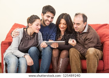 Happy Family on the Sofa with Digital Tablet - stock photo