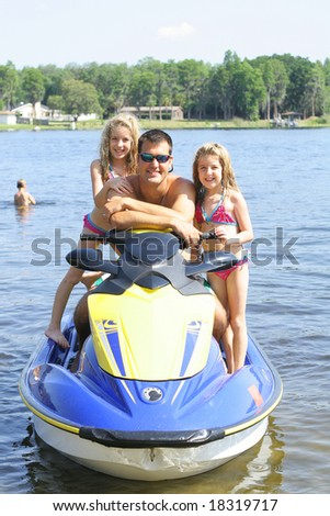 happy family on the water - stock photo