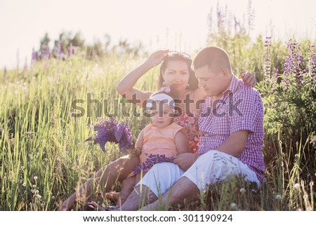 Happy family outdoor - stock photo