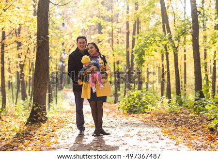 happy family outdoor in autumn