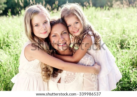 Happy Family outdoor. Mother and daughters. Mother's day