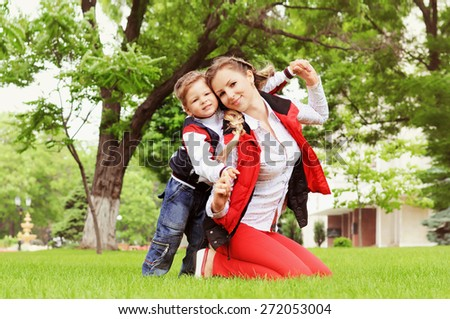 Happy Family Outdoors. Happy Mother and her Son having fun in park. - stock photo