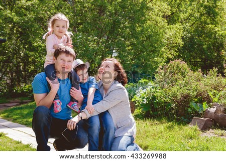 Happy Family Outdoors Mother Father Son Daughter - stock photo