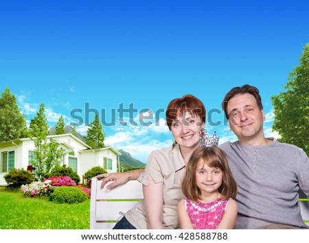Happy family outdoors sitting on the bench near house