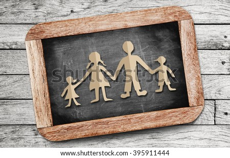 Happy family paper cut of eco on chalkboard background - stock photo