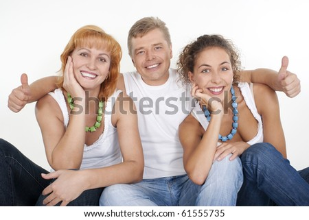 Happy family: parents with their grown-up daughter. - stock photo