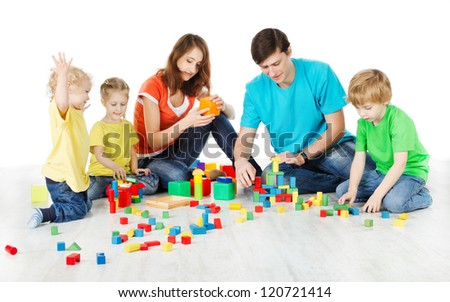 Happy family. Parents with three kids playing blocks over white - stock photo