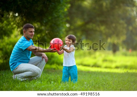 Happy Family playing ball outdoors summer activity - stock photo
