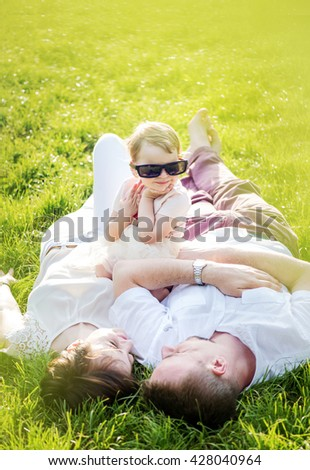 Happy family playing in park - stock photo