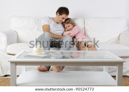 Happy family playing on a white sofa