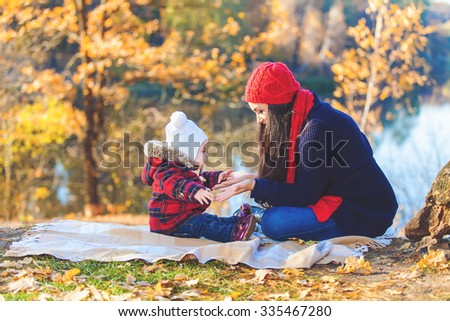 Happy family playing outdoors in park, Winter, autumn life