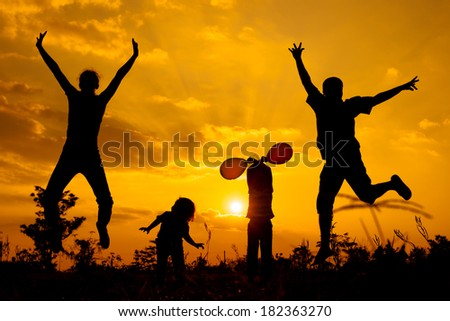 Happy  family playing with balloons on the  road in the  sunset time. Evening party on the nature - stock photo