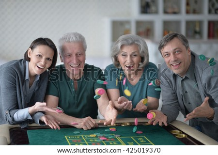 Happy family playing with casino chips  - stock photo