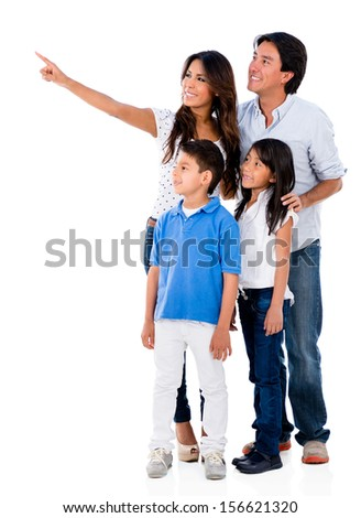 Happy family pointing away - isolated over a white background  - stock photo