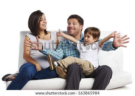 Happy Family portrait: Father, pregnant mother and son - stock photo