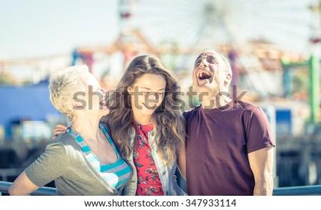 Happy family portrait in Santa Monica, Los angeles - stock photo