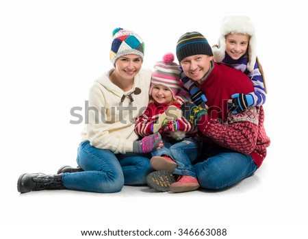 happy family portrait in warm clothes isolated on white background