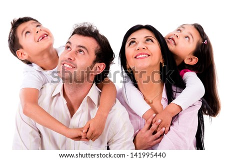 Happy family portrait looking up - isolated over white - stock photo