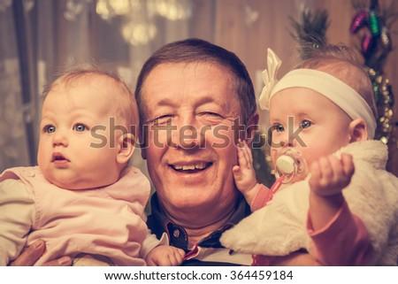 Happy family portrait of grandfather with his grandchildren - stock photo