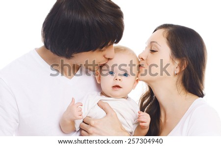 Happy family, portrait of mother and father kissing baby - stock photo