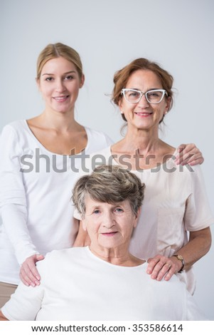 Happy family portrait of three beautiful females - stock photo