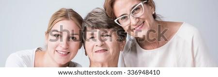 Happy family portrait of three women - stock photo