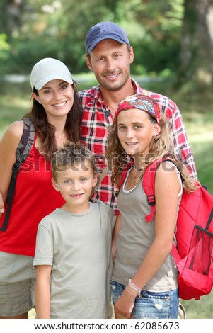 Happy family portrait on a hiking day - stock photo
