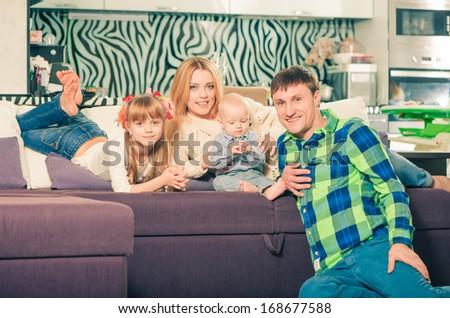 happy family portrait on a sofa - stock photo
