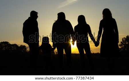 Happy family portrait outdoors over blue sky - stock photo