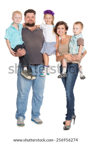 Happy family portrait smiling together in full growth - isolated on white background - stock photo