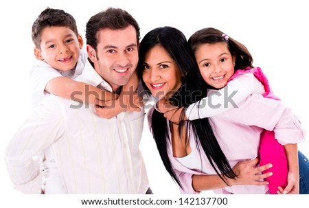 Happy family portrait smiling together - isolated over a white background - stock photo