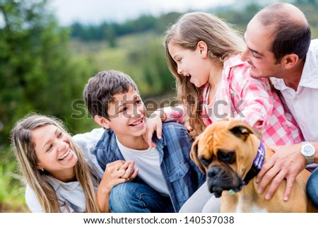 Happy family portrait with a dog - outdoors - stock photo
