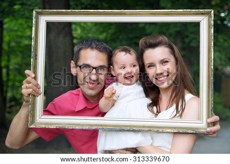 Happy family posing - stock photo