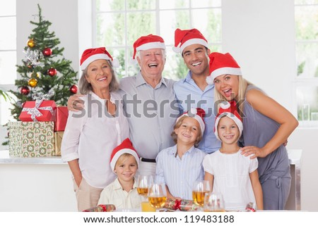 Happy family posing for photo at christmas - stock photo