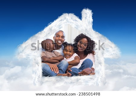 Happy family posing on the couch together against blue sky over clouds - stock photo